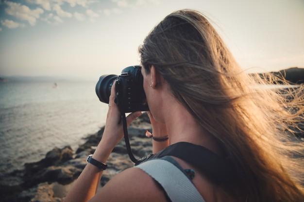 closeup-focus-shot-woman-taking-picture-sea-concept-photography_181624-35137